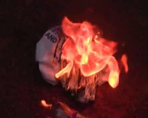 50 NPP members defect to NDC burn Akufo-Addo branded shirts