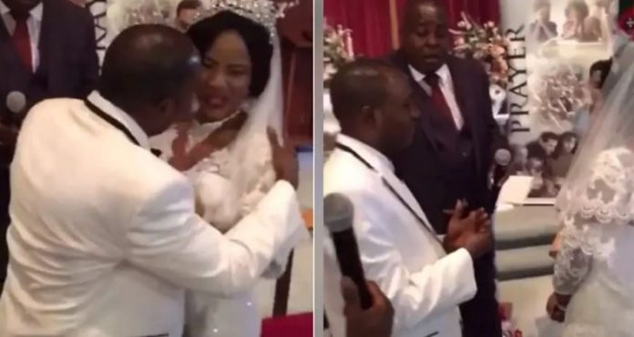 Angry bride pushes groom away as he tries to kiss her at the altar