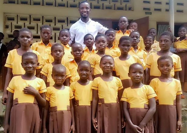 Comedian Teacher Kwadwo sews new school uniforms for pupils with his monthly salary | Airnewsonline