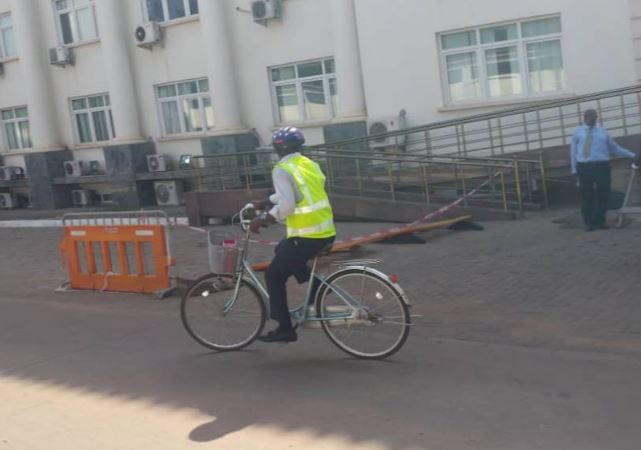 Ras Mubarak storms Parliament on a bicycle in protest against fuel price hikes
