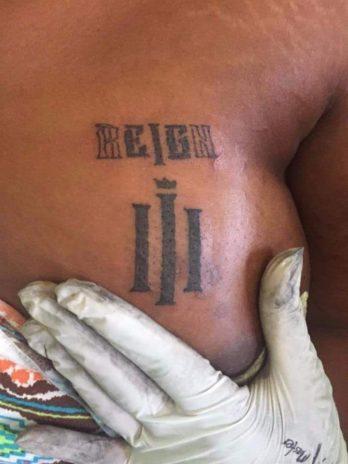 Reign album tattoo on breast