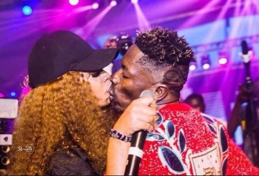 shatta wale and michy wild kissing photo